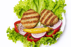 Meat cutlet with vegetable salad Stock Photography