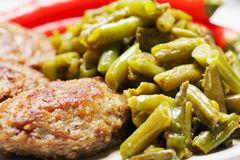 Meat cutlets with baked beans Stock Photography
