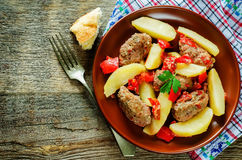 Meat cutlets baked with potatoes, tomatoes and red pepper Royalty Free Stock Photo