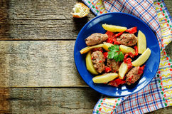 Meat cutlets baked with potatoes, tomatoes and red pepper Royalty Free Stock Photos