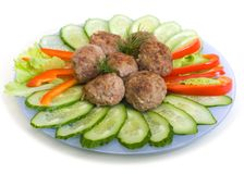 Meat cutlets and cucumber Royalty Free Stock Photography