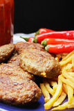 Meat cutlets with french fries Royalty Free Stock Image
