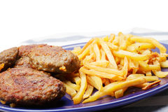 Meat cutlets with french fries Stock Images