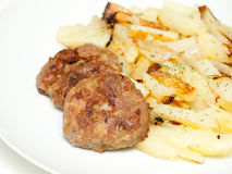 Meat cutlets with fried potatoes Stock Photography