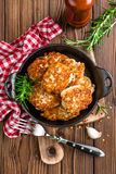 Meat cutlets in frying pan on wooden rustic table Stock Photo