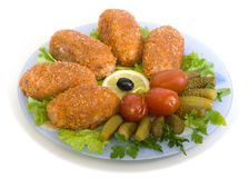 Meat cutlets and pickled cucumber Royalty Free Stock Photo