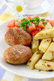 Meat cutlets with potato dumplings Royalty Free Stock Images