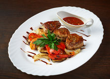 Meat cutlets with roasted vegetables and sauce Stock Image