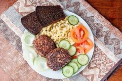Meat cutlets with vegetables Stock Image