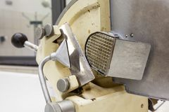 Meat cutter for corpses. This old meat cutter for corpses is still used Stock Photography