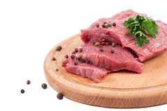 Meat on a cutting board on white background. Meat on a cutting board isolated on white background Stock Photo