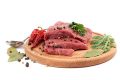 Meat on a cutting board on white background. Meat on a cutting board isolated on white background Stock Photos