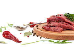 Meat on a cutting board on white background. Meat on a cutting board isolated on white background Royalty Free Stock Images