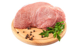 Meat on a cutting board on white background. Meat on a cutting board isolated on white background Royalty Free Stock Photo