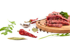 Meat on a cutting board on white background. Meat on a cutting board isolated on white background Royalty Free Stock Image