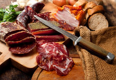 Meat delicacies Stock Photos