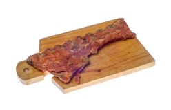 Meat delicatessen on the board Stock Images