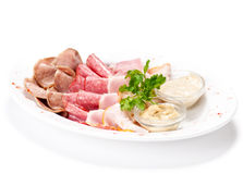 Meat delicatessen plate with souce Stock Photos