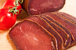Meat delicious basturma with cherry Royalty Free Stock Photos