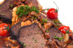 Meat dish. With tomato and mushroom Royalty Free Stock Image