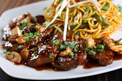Meat dish. With Noodles on white plate royalty free stock photo