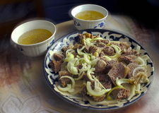 Meat dish beshbarmak. Traditional meat hot dish nomadic Turkic peoples Stock Image