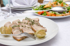 Meat dish at dinner table in restaurant. Meat dish at dinner table. Eating concept Royalty Free Stock Photo