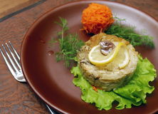 Meat dish with lemon Stock Images