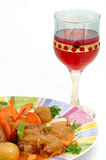 Meat dish with a red glass. Of wine (stifado greek receipe Stock Photo