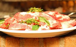 Meat dish with Rosemary ready to be cooked on the grill Royalty Free Stock Photography