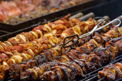 Meat dishes are prepared on open fire Royalty Free Stock Images