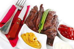 Meat and dishware Stock Photography