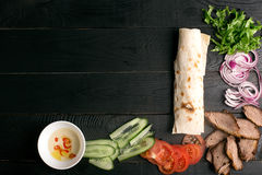 Meat doner kebab. Traditional meat doner kebab with vegetables. Background with copy space stock image