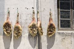 Meat drying. Legs of meat hanging in hte sun to cure at Hongcun, China Royalty Free Stock Images