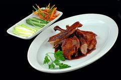 Meat of a duck with salad. On a black background royalty free stock photography