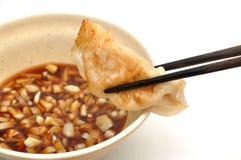 Meat dumpling. Eating meat dumpling with garlic soya sauce Royalty Free Stock Photography