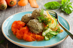 Meat dumplings with carrot puree and salad for dietary Stock Photography