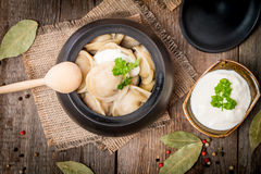 Meat Dumplings - russian pelmeni with sour cream Royalty Free Stock Image