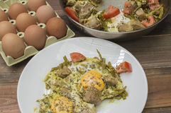 Meat with eggs and asparagus,. Eggs on the table Royalty Free Stock Photography