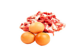 Meat and eggs. Fresh sliced raw meat and three raw eggs isolated on white background Royalty Free Stock Photos