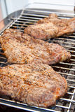 Meat on the electric barbecue Stock Images