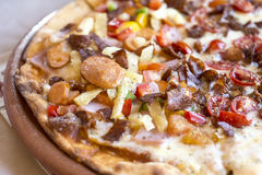 Meat feast Barbecue pizza with a topping of pepperoni, sausage, Royalty Free Stock Image