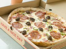 Meat Feast Pizza in a Take Away Box Royalty Free Stock Photography