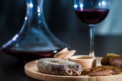 Meat fillet sausage and red wine Royalty Free Stock Image