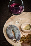Meat fillet sausage and red wine Stock Image
