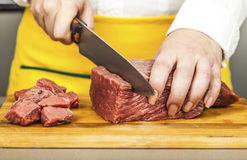 Meat fillet on a wooden board cubes Royalty Free Stock Photos