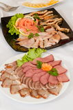 Meat and fish delicacies. Stock Images