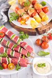 Meat and fish kebab Stock Images