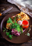 Meat with flat bread,greens and vegetables on ceramic plate. Stock Photos
