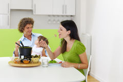 Meat fondue. Family eating meat fondue at home. Copy space royalty free stock images